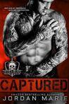Captured (Devil's Blaze MC, #1)